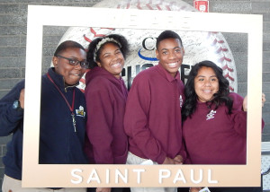 "Students from St. Paul City School posed in The St. Paul Foundation's ""I Am Saint Paul"" frame."