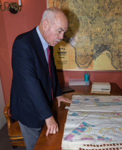 RCHS Board Chair Jim Miller examining a historic map during the Opening Ceremony of the Mary Livingston Griggs & Mary Griggs Burke Research Center.