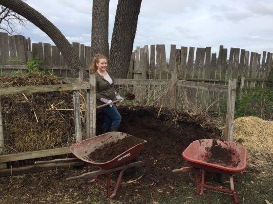 Volunteer shoveling compost